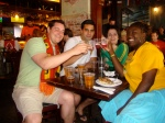 An Irish-Canadian, Spanish/Indian-Canadian, Brazilian and an American all took shots at a bar after the devastating losses of Brasil and Ghana